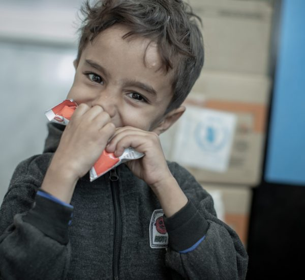 Yemen, Sana'a Governorate, Sana'a, 11 November 2019  WFP is providing ready-to-eat supplementary food to over 2 million women and children in Sana'a, Yemen to help treat and prevent chronic undernutrition.  In the Photo: 5-year-old Mohammed eats directly from a sachet of PlumpySup (a ready-to-eat nutritional supplement) at a WFP-managed nutrition clinic in Al Sabeen Hospital, Sana'a, Yemen.   Photo: WFP/Mohammed Awadh